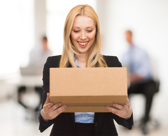 Woman with cardboard box in office
