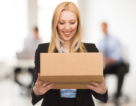 Woman with cardboard box in office image small