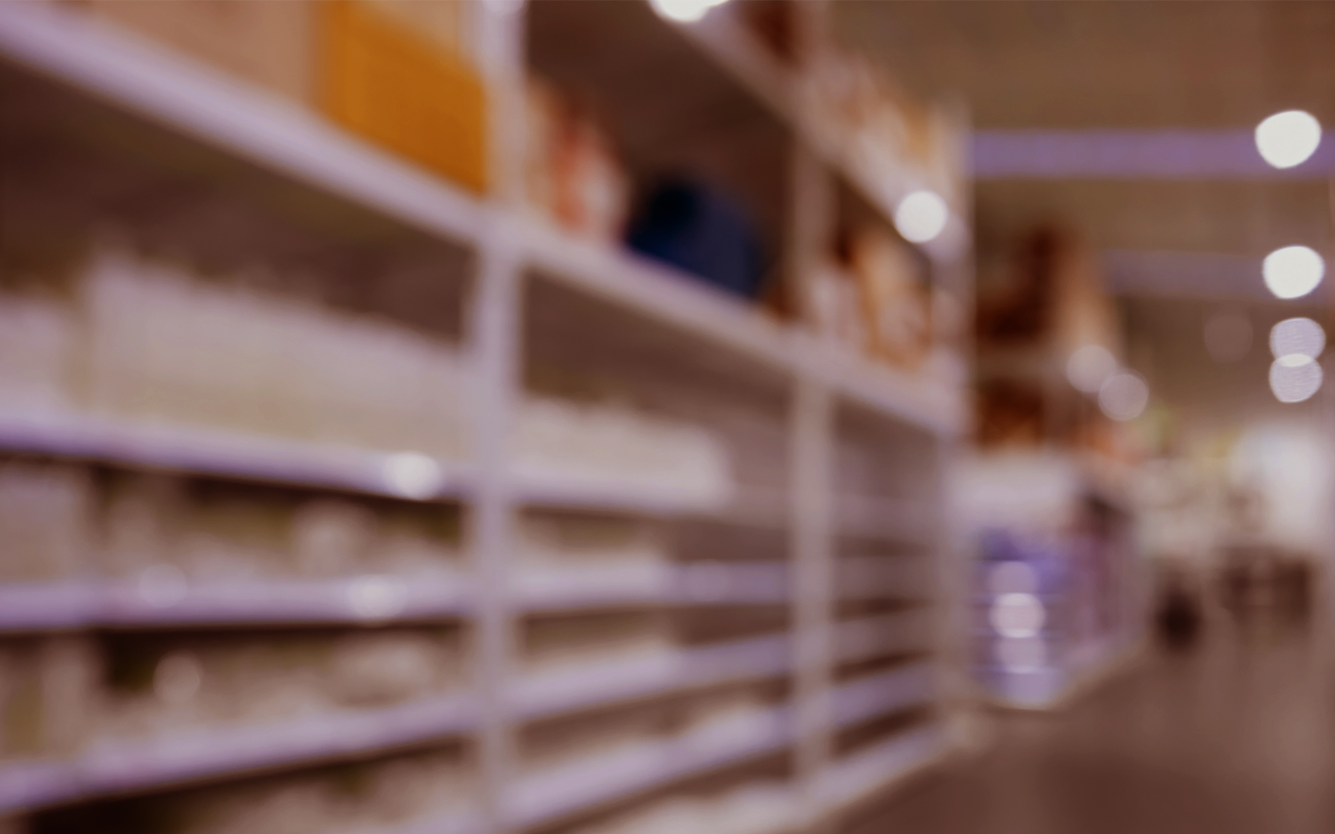 Blurred shelf storage in shop warehouse perspective background image