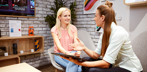 Two women in a sales conversation