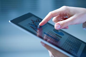 Close-up of hands touching digital tablet with business diagram image small