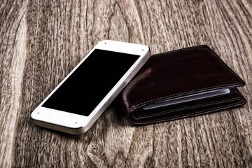 Mobile phone and black leather wallet image small