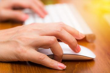 Hand using keyboard and mouse in office work place image small