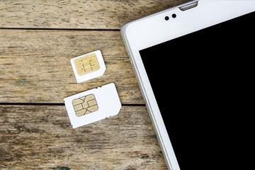 Sim cards next to mobile phone image small
